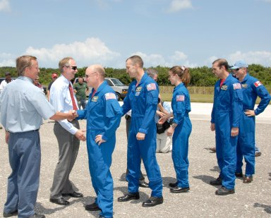 KENNEDY SPACE CENTER, FLA. -- The STS-118 crew is welcomed back to Earth by NASA officials after completing mission STS-118. From left are Shuttle Launch Director Mike Leinbach, Associate Administrator for Space Operations William Gerstenmaier, Commander Scott Kelly, Pilot Charlie Hobaugh, NASA Administrator Mike Griffin, and Mission Specialists Tracy Caldwell, Rick Mastracchio and Canadian astronaut Dave Williams. On the mission, the crew installed a new gyroscope, an external spare parts platform and another truss segment to the expanding station. Endeavour's main gear touched down at 12:32:16 p.m. EDT. Nose gear touchdown was at 12:32:29 p.m. and wheel stop was at 12:33:20 p.m. Endeavour landed on orbit 201. STS-118 was the 119th space shuttle flight, the 22nd flight to the station, the 20th flight for Endeavour and the second of four missions planned for 2007. This was the 65th landing of an orbiter at Kennedy. Photo credit: NASA/Kim Shiflett