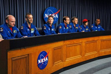 KENNEDY SPACE CENTER, FLA. -- At the NASA television studio, the STS-118 crew members answer questions from the media during a news conference. Seated from left are Commander Scott Kelly, Pilot Charlie Hobaugh and Mission Specialists Tracy Caldwell, Rick Mastracchio, Dave Williams, Barbara R. Morgan and Alvin Drew. The crew has just returned from a 13-day mission to the International Space Station. On the mission, the crew installed a new gyroscope, an external spare parts platform and another truss segment to the expanding station. STS-118 was the 119th space shuttle flight, the 22nd flight to the station, the 20th flight for Endeavour and the second of four missions planned for 2007. Photo credit: NASA/George Shelton