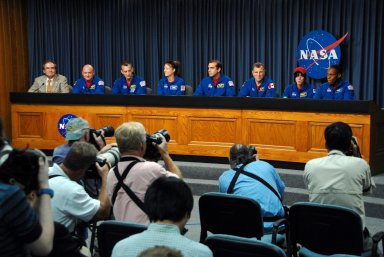 KENNEDY SPACE CENTER, FLA. -- At the NASA television studio, photographers focus on STS-118 Mission Specialist Barbara R. Morgan (second from right) as she answers a question about her experiences during the mission. Others seated at the dais (from left) are NASA Public Information Officer George Diller, Commander Scott Kelly, Pilot Charlie Hobaugh and Mission Specialists Tracy Caldwell, Rick Mastracchio, Dave Williams and Alvin Drew. The crew has just returned from a 13-day mission to the International Space Station. On the mission, the crew installed a new gyroscope, an external spare parts platform and another truss segment to the expanding station. STS-118 was the 119th space shuttle flight, the 22nd flight to the station, the 20th flight for Endeavour and the second of four missions planned for 2007. Photo credit: NASA/George Shelton