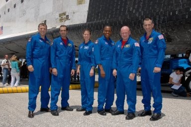 KENNEDY SPACE CENTER, FLA. -- Concluding their successful return to Earth on mission STS-118, the STS-118 crew pose for a photo alongside Endeavour after checking out the orbiter. From left are Mission Specialists Dave Williams, Rick Mastracchio, Tracy Caldwell and Alvin Drew, Commander Scott Kelly and Pilot Charlie Hobaugh. Not pictures is Mission Specialist Barbara R. Morgan. On the mission, the crew installed a new gyroscope, an external spare parts platform and another truss segment to the expanding station. Endeavour's main gear touched down at 12:32:16 p.m. EDT. Nose gear touchdown was at 12:32:29 p.m. and wheel stop was at 12:33:20 p.m. Endeavour landed on orbit 201. STS-118 was the 119th space shuttle flight, the 22nd flight to the station, the 20th flight for Endeavour and the second of four missions planned for 2007. This was the 65th landing of an orbiter at Kennedy. Photo credit: NASA/Kim Shiflett