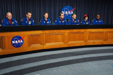 KENNEDY SPACE CENTER, FLA. -- At the NASA television studio, the STS-118 crew members participate in a news conference. Seated from left are Commander Scott Kelly, Pilot Charlie Hobaugh and Mission Specialists Tracy Caldwell, Rick Mastracchio, Dave Williams, Barbara R. Morgan and Alvin Drew. The crew has just returned from a 13-day mission to the International Space Station. On the mission, the crew installed a new gyroscope, an external spare parts platform and another truss segment to the expanding station. STS-118 was the 119th space shuttle flight, the 22nd flight to the station, the 20th flight for Endeavour and the second of four missions planned for 2007. Photo credit: NASA/George Shelton