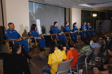 KENNEDY SPACE CENTER, FLA. -- At Walt Disney World in Orlando, the crew members of space shuttle mission STS-118 answer questions from the student audience during a special event to honor the Endeavour crew. Seated from left are Mission Specialists Alvin Drew, Barbara R. Morgan, Dave Williams, Rick Mastracchio and Tracy Caldwell; Pilot Charlie Hobaugh; and Commander Scott Kelly. The event also honored teacher-turned-astronaut Morgan, who dedicated a plaque outside the Mission: Space attraction. Other activities included meeting with the media and a parade down Main Street. Mission STS-118 was the 119th shuttle program flight and the 22nd flight to the International Space Station. Space shuttle Endeavour launched from NASA's Kennedy Space Center on Aug. 8 and landed Aug. 21. The mission delivered the S5 truss, continuing the assembly of the space station. Photo credit: NASA/George Shelton