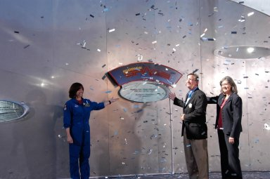 KENNEDY SPACE CENTER, FLA. -- During a special event at Walt Disney World in Orlando honoring the crew of space shuttle mission STS-118, Mission Specialist Barbara R. Morgan (left) helps dedicate a plaque outside the Mission: Space attraction. At right are Vice President of Epcot Jim MacPhee and NASA Assistant Administrator for Education Joyce Winterton. Along with the dedication, the crew met with students and media and paraded down Main Street to the delight of the crowds. The other crew members attending were Commander Scott Kelly, Pilot Charlie Hobaugh and Mission Specialists Tracy Caldwell, Rick Mastracchio, Dave Williams and Alvin Drew. Mission STS-118 was the 119th shuttle program flight and the 22nd flight to the International Space Station. Space shuttle Endeavour launched from NASA's Kennedy Space Center on Aug. 8 and landed Aug. 21. The mission delivered the S5 truss, continuing the assembly of the space station. Photo credit: NASA/George Shelton