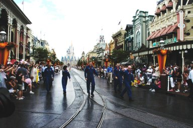 KENNEDY SPACE CENTER, FLA. -- Members of the space shuttle mission STS-118 crew march down Main Street at Walt Disney World in Orlando. From left are Mission Specialists Alvin Drew, Barbara R. Morgan and Dave Williams, Pilot Charlie Hobaugh, Mission Specialist Tracy Caldwell and Commander Scott Kelly. Not pictured but present is Mission Specialist Rick Mastracchio. The event also honored teacher-turned-astronaut Morgan, who dedicated a plaque outside the Mission: Space attraction. Other activities included meeting with the media and students. Mission STS-118 was the 119th shuttle program flight and the 22nd flight to the International Space Station. Space shuttle Endeavour launched from NASA's Kennedy Space Center on Aug. 8 and landed Aug. 21. The mission delivered the S5 truss, continuing the assembly of the space station. Photo credit: NASA/George Shelton