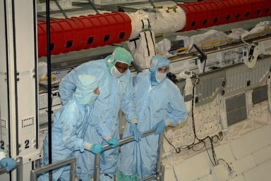 KENNEDY SPACE CENTER, FLA. -- STS-122 crew members take a ride inside space shuttle Atlantis' payload bay to examine components installed there. Seen here are Mission Specialists Leland Melvin (center) and Rex Walheim (right). The crew is at Kennedy Space Center to take part in a crew equipment interface test, which includes equipment familiarization. The mission will carry and install the Columbus Lab, a multifunctional, pressurized laboratory that will be permanently attached to Node 2 of the space station to carry out experiments in materials science, fluid physics and biosciences, as well as to perform a number of technological applications. It is Europe?s largest contribution to the construction of the International Space Station and will support scientific and technological research in a microgravity environment. STS-122 is targeted for launch in December. Photo credit: NASA/Kim Shiflett