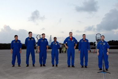 KENNEDY SPACE CENTER, FLA. -- The crew members of mission STS-120 speak to the media following their arrival at NASA's Kennedy Space Center Shuttle Landing Facility aboard T-38 jet aircraft to take part in terminal countdown demonstration test activities. From left are Mission Specialists Daniel Tani, Paolo Nespoli, Doug Wheelock, Stephanie Wilson, Scott Parazynski; Pilot George Zamka and Commander Pam Melroy. The terminal countdown demonstration test provides astronauts and ground crews an opportunity to participate in various simulated countdown activities, including equipment familiarization and emergency training. The STS-120 mission will deliver the U.S. Node 2 module, named Harmony, aboard space shuttle Discovery to the International Space Station. Launch of Discovery on mission STS-120 is targeted for Oct. 23 at 11:38 a.m. EDT on a 14-day mission to the International Space Station. Photo credit: NASA/Kim Shiflett
