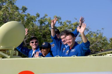 KENNEDY SPACE CENTER, FLA. -- STS-120 crew members signal their pleasure in participating in M-113 driving practice, part of emergency exit procedures from Launch Pad 39A. Seen here on the M-113 are Mission Specialists Scott Parazynski, Stephanie Wilson, Daniel Tani, Paolo Nespoli and Doug Wheelock. Nespoli represents the European Space Agency. The training is part of terminal countdown demonstration test, or TCDT, activities the crew is undertaking at NASA's Kennedy Space Center. The TCDT also includes equipment familiarization and a simulated launch countdown. Mission STS-120, which will carry the Italian-built U.S. Node 2 to the International Space Station, is targeted for launch on Oct. 23. Photo credit: NASA/Kim Shiflett