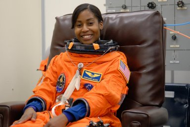 KENNEDY SPACE CENTER, FLA. -- STS-120 Mission Specialist Stephanie Wilson tries on her launch and entry suit, preparing for launch. The fitting is part of terminal countdown demonstration test, or TCDT, activities the crew is undertaking at NASA's Kennedy Space Center. The TCDT also includes emergency egress procedures, equipment familiarization and a simulated launch countdown. Mission STS-120, which will carry the Italian-built U.S. Node 2 to the International Space Station, is targeted for launch on Oct. 23. Photo credit: NASA/Kim Shiflett