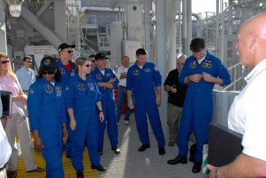 KENNEDY SPACE CENTER, FLA. -- The STS-120 crew is at NASA's Kennedy Space Center for the pre-launch terminal countdown demonstration test, or TCDT. Here, the crew gets instructions about emergency egress from the fixed service structure. From left are Mission Specialists Stephanie Wilson and Scott Parazynski, Commander Pamela Melroy, Pilot George Zamka, and Mission Specialists Daniel Tani, Doug Wheelock and Paolo Nespoli, who represents the European Space Agency. After the mission, Tani will remain aboard the International Space Station and return with the STS-122 crew, targeted to launch Dec. 6. The TCDT provides astronauts and ground crews an opportunity to participate in various simulated countdown activities, including equipment familiarization and emergency training. The STS-120 mission will deliver the U.S. Node 2 module, named Harmony, aboard space shuttle Discovery to the International Space Station. Launch of Discovery on mission STS-120 is targeted for Oct. 23 at 11:38 a.m. EDT on a 14-day mission. Photo credit: NASA/Kim Shiflett