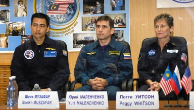 Baikonur, Kazakhstan -- Flight Engineer and Soyuz Commander Yuri Malenchenko and Malaysian Spaceflight Participant Sheikh Muszaphar Shukor are protected behind glass during the State Commission meeting and press conference Oct. 9, 2007, at the Baikonur Cosmodrome in Kazakhstan. The crew is in preparation for their launch to the International Space Station Oct. 10 in their Soyuz TMA-11 spacecraft. Whitson and Malenchenko will spend six months on the station while Shukor will return to Earth Oct. 21 with two of the Expedition 15 crewmembers currently on the complex. Photo credit: NASA/Bill Ingalls