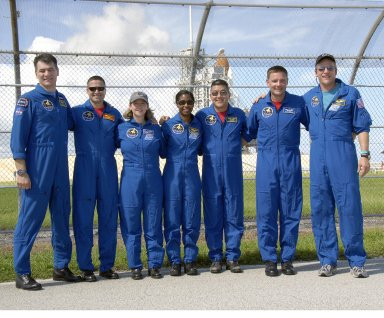 KENNEDY SPACE CENTER, FLA. -- At NASA's Kennedy Space Center, the STS-120 crew enjoy a photo moment during a final daylight excursion to the launch pad the day before launch. From left are Mission Specialist Paolo Nespoli, Pilot George Zamka, Commander Pamela Melroy and Mission Specialists Stephanie Wilson, Daniel Tani, Doug Wheelock and Scott Parazynski. Nespoli represents the European Space Agency. Tani will be remaining on the International Space Station to join the Expedition 16 crew after the mission is complete. Liftoff of space shuttle Discovery is scheduled for 11:38 a.m. EDT Oct. 23. The mission will be the 23rd assembly flight to the International Space Station and the 34th flight for Discovery. Payload on the mission is the Italian-built U.S. Node 2, called Harmony. On the 14-day mission, the crew will install Harmony and move the P6 solar arrays to their permanent position and deploy them. Discovery is expected to complete its mission and return home at 4:47 a.m. EST on Nov. 6. Photo credit: NASA/Kim Shiflett