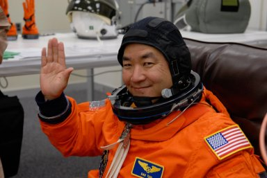 KENNEDY SPACE CENTER, FLA. -- At NASA's Kennedy Space Center, the STS-120 crew don their launch and entry suits before heading to Launch Pad 39A for launch aboard space shuttle Discovery to the International Space Station. Seen here is Mission Specialist Daniel Tani, who is making his second shuttle flight. Tani will be remaining on the International Space Station to join the Expedition 16 crew after the mission is complete. Discovery is scheduled for liftoff at 11:38 a.m. EDT. The mission will be the 23rd assembly flight to the space station and the 34th flight for Discovery. Payload on the mission is the Italian-built U.S. Node 2, called Harmony. During the 14-day mission, the crew will install Harmony and move the P6 solar arrays to their permanent position and deploy them. Discovery is expected to complete its mission and return home at 4:47 a.m. EST on Nov. 6. Photo credit: NASA/Kim Shiflett