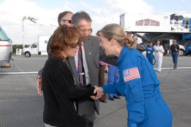 KENNEDY SPACE CENTER, FLA. -- STS-120 Commander Pamela Melroy is greeted by NASA Administrator Mike Griffin and his wife, Rebecca Griffin. Melroy and the Discovery crew completed the 15-day mission STS-120, with an on-time landing at 1:01:16 p.m. Wheel stop was at 1:02:07 p.m. Mission elapsed time was 15 days, 2 hours, 24 minutes and 2 seconds.Mission STS-120 continued the construction of the station with the installation of the Harmony Node 2 module and the relocation of the P6 truss. Photo credit: NASA//Kim Shiflett