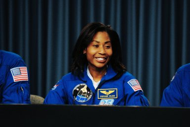 KENNEDY SPACE CENTER, FLA. -- STS-120 mission specialist Stephanie Wilson takes part in a news conference after the crew's successful landing aboard space shuttle Discovery at NASA's Kennedy Space Center. The crew completed a 15-day mission to the International Space Station with a smooth landing on Runway 33. Main gear touchdown was 1:01:16 p.m. Wheel stop was at 1:02:07 p.m. Mission elapsed time was 15 days, 2 hours, 24 minutes and 2 seconds. Mission STS-120 continued the construction of the station with the installation of the Harmony Node 2 module and the relocation of the P6 truss. Photo credit: NASA/Kim Shiflett