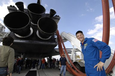 KENNEDY SPACE CENTER, FLA. -- Astronaut Scott Parazynski smiles for a photo while he and the crew of STS-120 walk around and look at the underside of the space shuttle Discovery shortly after their 1:01 p.m. EST landing at NASA's Kennedy Space Center in Florida. Parazynski performed a repair of a damaged solar array during one of his spacewalks at the International Space Station. Photo credit: NASA/Bill Ingalls