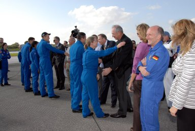 KENNEDY SPACE CENTER, FLA. -- The STS-120 crew members are greeted by NASA and Kennedy VIPs after completing their successful mission. From left are STS-120 mission specialists Doug Wheelock, Stephanie Wilson and Scott Parazynski, Pilot George Zamka and Commander Pamela Melroy. The NASA VIPs include NASA Administrator Mike Griffin, Associate Administrator for NASA Space Operations William Gerstenmaier and Shuttle Program Manager Wayne Hale. The lineup also includes Shuttle Launch Director Mike Leinbach. Melroy and the Discovery crew completed the 15-day mission STS-120, with an on-time landing at 1:01:16 p.m. Wheel stop was at 1:02:07 p.m. Mission elapsed time was 15 days, 2 hours, 24 minutes and 2 seconds. Mission elapsed time was 15 days, 2 hours, 24 minutes and 2 seconds. Mission STS-120 continued the construction of the station with the installation of the Harmony Node 2 module and the relocation of the P6 truss. Photo credit: NASA/Kim Shiflett