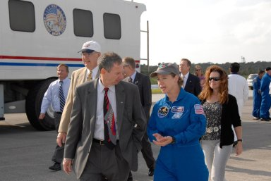 KENNEDY SPACE CENTER, FLA. -- NASA Administrator Mike Griffin talks to STS-120 Commander Pamela Melroy as they walk across the Shuttle Landing Facility at NASA's Kennedy Space Center. On the left are Shuttle Launch Director Mike Leinbach and Shuttle Program Manager Wayne Hale. At right is Rebecca Griffin, wife of the administrator. Melroy and the Discovery crew completed the 15-day mission STS-120, with an on-time landing at 1:01:16 p.m. Wheel stop was at 1:02:07 p.m. Mission elapsed time was 15 days, 2 hours, 24 minutes and 2 seconds. Mission STS-120 continued the construction of the station with the installation of the Harmony Node 2 module and the relocation of the P6 truss. Photo credit: NASA/Kim Shiflett