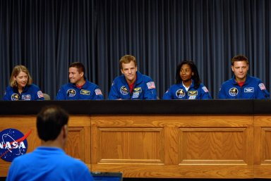 KENNEDY SPACE CENTER, FLA. -- Members of the STS-120 crew take part in a news conference after their successful landing aboard space shuttle Discovery at NASA's Kennedy Space Center. From left are Commander Pamela Melroy, Pilot George Zamka and mission specialists Scott Parazynski, Stephanie Wilson and Doug Wheelock. The crew completed a 15-day mission to the International Space Station with a smooth landing on Runway 33. Main gear touchdown was 1:01:16 p.m. Wheel stop was at 1:02:07 p.m. Mission elapsed time was 15 days, 2 hours, 24 minutes and 2 seconds. Mission STS-120 continued the construction of the station with the installation of the Harmony Node 2 module and the relocation of the P6 truss. Photo credit: NASA/Kim Shiflett