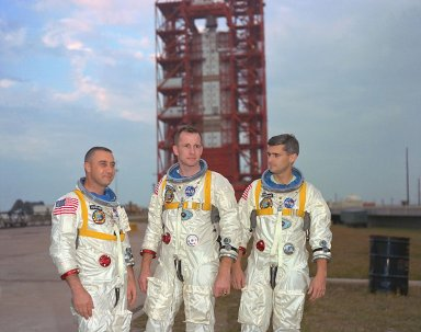 KENNEDY SPACE CENTER, FLA. -- Astronauts, left to right, Gus Grissom, Ed White, and Roger Chaffee, pose in front of Launch Complex 34 which is housing their Saturn 1 launch vehicle. The astronauts are scheduled for the Apollo Saturn 204 (Apollo 1) mission.
