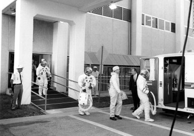 KENNEDY SPACE CENTER, FLA. -- Apollo 7 astronauts enter transfer van, which transported them to Cape Kennedy's Launch Complex 34 and their Saturn IB space vehicle that lifted off at 11:03 a.m. EDT, Oct. 11, 1968. First to enter the transfer van was Donn F. Eisele, command module pilot, followed by Walter Cunningham, lunar module pilot, and Walter M. Schirra Jr., Apollo 7 commander. The space pilots are scheduled to orbit the Earth 11 days, gathering information for future lunar voyages directed by the National Aeronautics and Space Administration.