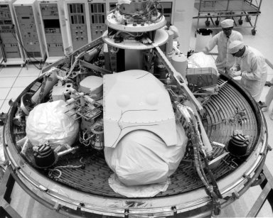 KENNEDY SPACE CENTER, FLA. -- Technicians inspect Viking Lander 2 in KSC's Spacecraft Assembly and Encapsulation Facility #1. The first Viking is scheduled for launch from KSC's Launch Complex 41 no earlier than Aug. 11; the second, no earlier than Aug. 21. Once in orbit around Mars, the lander will detach and descend to the planet's surface to conduct further investigation. The Viking's 440-million-mile journey to the Red Planet will take about 11 months.