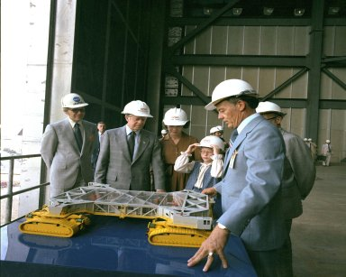 KENNEDY SPACE CENTER, FLA. -- President Jimmy Carter, with wife Rosalynn and daughter Amy, listen to Center Director Lee R. Scherer explain a model of the crawler transporter during their tour of the Kennedy Space Center.
