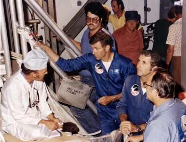 KENNEDY SPACE CENTER, FLA. -- At Pad A, Launch Complex 39, astronauts Joe Engle, left, and Richard Truly talk with technicians and inspect the Space Shuttle vehicle that will propel them into orbit later this fall.