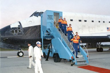 KENNEDY SPACE CENTER, FLA. -- The STS-38 flight crew disembark from the orbiter Atlantis after a successful landing at KSC's Shuttle Landing Facility. From bottom up are Commander Richard Covey, Pilot Frank Culbertson and Mission Specialists Robert Springer, Charles Gemar and Carl Meade.