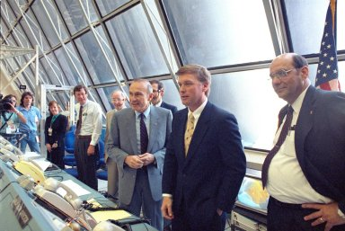 KENNEDY SPACE CENTER, FLA. -- Vice President Dan Quayle [second from right] is briefed on firing room activities during the Terminal Countdown Demonstration Test. Explaining the launch team's role are Launch Director Robert Sieck (left of Quayle) and NASA Deputy Administrator J.R. Thompson (right). Quayle spoke with the STS-39 flight crew and met launch team members, toured Center facilities, gave a speech, and held a press conference.