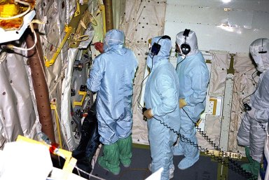 KENNEDY SPACE CENTER, FLA. -- United Space Alliance (USA) technicians in Orbiter Processing Facility Bay 1 troubleshoot the orbiter Columbia?s outer hatch of the airlock, which failed to open during the recent STS-80 Space Shuttle mission. Mission Specialists Tamara E. Jernigan and Thomas D. Jones did not perform the mission?s planned two extravehicular activities (EVAs) or spacewalks because the hatch would not open on orbit. The spacewalks were to be part of the continuing series of EVA Development Flight Tests to evaluate equipment and procedures and to build spacewalking experience in preparation for the International Space Station.
