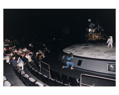 """KENNEDY SPACE CENTER, FLA. -- Some of the former Apollo program astronauts observe a Lunar Module and Moon mockup during a tour the new Apollo/Saturn V Center (ASVC) at KSC prior to the gala grand opening ceremony for the facility that was held Jan. 8, 1997. The astronauts were invited to participate in the event, which also featured NASA Administrator Dan Goldin and KSC Director Jay Honeycutt. Some of the visiting astonauts were (from left): Apollo 10 Lunar Module Pilot and Apollo 17 Commander Eugene A. Cernan; Apollo 9 Lunar Module Pilot Russell L. Schweikart; Apollo 10 Command Module Pilot and Apollo 16 Commander John W. Young; Apollo 10 Commander Thomas P. Stafford; and Apollo 11 Lunar Module Pilot Edwin E. """"Buzz"""" Aldrin, Jr. The ASVC also features several other Apollo program spacecraft components, multimedia presentations and a simulated Apollo/Saturn V liftoff. The facility will be a part of the KSC bus tour that embarks from the KSC Visitor Center"""