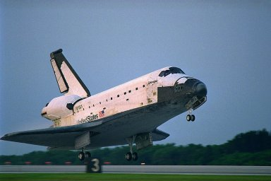 KENNEDY SPACE CENTER, FLA. -- The Space Shuttle orbiter Columbia touches down on Runway 33 at KSC?s Shuttle Landing Facility at 6:46:34 a.m. EDT with Mission Commander James D. Halsell Jr. and Pilot Susan L. Still at the controls to complete the STS-94 mission. Also on board are Mission Specialist Donald A. Thomas, Mission Specialist Michael L. Gernhardt, Payload Commander Janice Voss, and Payload Specialists Roger K. Crouch and Gregory T. Linteris. During the Microgravity Science Laboratory-1 (MSL-1) mission, the Spacelab module was used to test some of the hardware, facilities and procedures that are planned for use on the International Space Station while the flight crew conducted combustion, protein crystal growth and materials processing experiments. This mission was a reflight of the STS-83 mission that lifted off from KSC in April of this year. That space flight was cut short due to indications of a faulty fuel cell. This was Columbia?s 11th landing at KSC and the 38th landing at the space center in the history of the Shuttle program