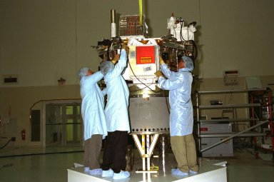 Workers from the Johns Hopkins University?s Applied Physics Laboratory (APL) install the Cosmic Ray Isotope Spectrometer (CRIS) on the Advanced Composition Explorer (ACE) spacecraft in KSC?s Spacecraft Assembly and Encapsulation Facility-2 (SAEF-2). From left, are Al Sadilek, Marcos Gonzalez and Cliff Willey. CRIS is one of nine instruments on ACE, which will investigate the origin and evolution of solar phenomenon, the formation of the solar corona, solar flares and the acceleration of the solar wind. ACE was developed for NASA by the APL. The spacecraft is scheduled to be launched Aug. 21 aboard a two-stage Delta II 7920-8 rocket from Space Launch Complex 17, Pad A