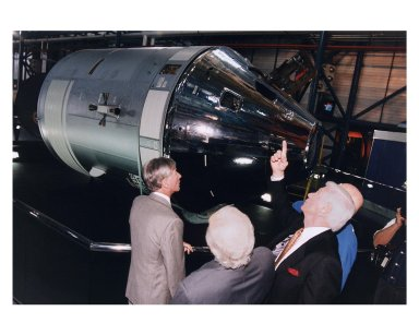 """KENNEDY SPACE CENTER, FLA. -- Some of the former Apollo program astronauts admire an Apollo Command and Service Module during a tour the new Apollo/Saturn V Center (ASVC) at KSC prior to the gala grand opening ceremony for the facility that was held Jan. 8, 1997. The astronauts were invited to participate in the event, which also featured NASA Administrator Dan Goldin and KSC Director Jay Honeycutt. The astronauts are (from left): Apollo 10 Command Module Pilot and Apollo 16 Commander John W. Young;. Apollo 11 Lunar Module Pilot Edwin E. """"Buzz"""" Aldrin, Jr.; Apollo 17 Commander Eugene A. Cernan; and Apollo 10 Commander Thomas P. Stafford. The ASVC also features several other Apollo program spacecraft components, multimedia presentations and a simulated Apollo/Saturn V liftoff. The facility will be a part of the KSC bus tour that embarks from the KSC Visitor Center"""