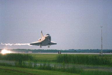 KENNEDY SPACE CENTER, FLA. -- The Space Shuttle orbiter Columbia glides in for a touchdown on Runway 33 at KSC?s Shuttle Landing Facility at approximately 6:46 a.m. EDT with Mission Commander James D. Halsell Jr. and Pilot Susan L. Still at the controls to complete the STS-94 mission. Also on board are Mission Specialist Donald A. Thomas, Mission Specialist Michael L. Gernhardt, Payload Commander Janice Voss, and Payload Specialists Roger K.Crouch and Gregory T. Linteris. During the Microgravity Science Laboratory-1 (MSL-1) mission, the Spacelab module was used to test some of the hardware, facilities and procedures that are planned for use on the International Space Station while the flight crew conducted combustion, protein crystal growth and materials processing experiments. This mission was a reflight of the STS-83 mission that lifted off from KSC in April of this year. That space flight was cut short due to indications of a faulty fuel cell