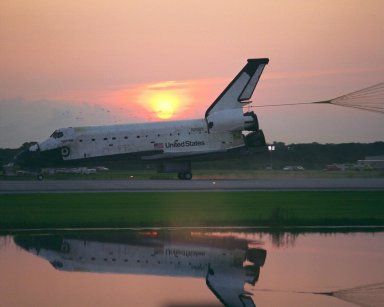 KENNEDY SPACE CENTER, FLA. -- With its drag chute deployed, the Space Shuttle Orbiter Columbia touches down on Runway 33 at KSC?s Shuttle Landing Facility at 6:46:34 a.m. EDT with Mission Commander James D. Halsell Jr. and Pilot Susan L. Still at the controls to complete the STS-94 mission. Also on board are Mission Specialist Donald A. Thomas, Mission Specialist Michael L. Gernhardt , Payload Commander Janice Voss, and Payload Specialists Roger K. Crouch and Gregory T. Linteris. Mission elapsed time for STS-94 was 15 days,16 hours, 44 seconds. During the Microgravity Science Laboratory-1 (MSL-1) mission, the Spacelab module was used to test some of the hardware, facilities and procedures that are planned for use on the International Space Station while the flight crew conducted combustion, protein crystal growth and materials processing experiments. This mission was a reflight of the STS-83 mission that lifted off from KSC in April of this year. That space flight was cut short due to indications of a faulty fuel cell. This was Columbia?s 11th landing at KSC and the 38th landing at the space center in the history of the Shuttle program