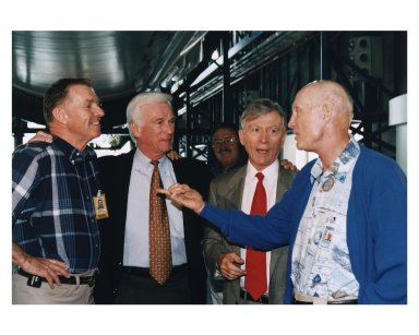 KENNEDY SPACE CENTER, FLA. -- Some of the former Apollo program astronauts recall the past as they tour the new Apollo/Saturn V Center (ASVC) at KSC prior to the gala grand opening ceremony for the facility that was held Jan. 8, 1997. The astronauts were invited to participate in the event, which also featured NASA Administrator Dan Goldin and KSC Director Jay Honeycutt. Standing underneath the KSC Apollo/Saturn V inside the building are (from left): Apollo 14 Back-up Lunar Module Pilot Joe H. Engle; Apollo 10 Lunar Module Pilot and Apollo 17 Commander Eugene A. Cernan; Apollo 10 Command Module Pilot and Apollo 16 Commander John W. Young; and Apollo 10 Commander Thomas P. Stafford. The ASVC also features several other Apollo program spacecraft components, multimedia presentations and a simulated Apollo/Saturn V liftoff. The facility will be a part of the KSC bus tour that embarks from the KSC Visitor Center
