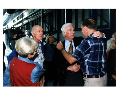 KENNEDY SPACE CENTER, FLA. -- Some of the former Apollo program astronauts tour the new Apollo/Saturn V Center (ASVC) at KSC prior to the gala grand opening ceremony for the facility that was held Jan. 8, 1997. The astronauts were invited to participate in the event, which also featured NASA Administrator Dan Goldin and KSC Director Jay Honeycutt. Greeting friends in the ASVC (left) is Apollo 10 Commander Thomas P. Stafford. Apollo 10 Lunar Module Pilot and Apollo 17 Commander Eugene A. Cernan shakes hands with Apollo 14 Back-up Lunar Module Pilot Joe H. Engle. The ASVC also features several other Apollo program spacecraft components, multimedia presentations and a simulated Apollo/ Saturn V liftoff. The facility will be a part of the KSC bus tour that embarks from the KSC Visitor Center