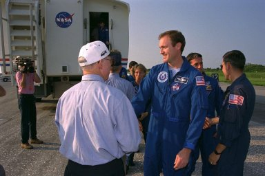 STS-94 Mission Commander James D. Halsell Jr. (center) shakes hands with KSC Shuttle Launch Director James F. Harrington (in white cap) after an end-of-mission landing on Runway 33 of KSC?s Shuttle Landing Facility July 17 to complete the Microgravity Science Laboratory-1 (MSL-1) mission. Main gear touchdown occurred at 6:46:34 a.m. EDT, July 17. At right, STS-88 Mission Commander and Shuttle Training Aircraft (STA) pilot Robert D. Cabana greets STS-94 Mission Specialist Donald A. Thomas. In the background, KSC Center Director Roy D. Bridges Jr. meets with other members of the STS-94 crew