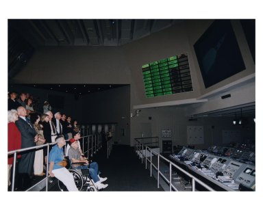 KENNEDY SPACE CENTER, FLA. -- Several Apollo program astronauts, along with their family members and friends, watch a simulation of an Apollo/Saturn V launch in a replica of a Launch Control Center firing room in the new Apollo/Saturn V Center (ASVC) at KSC prior to the gala grand opening ceremony for the facility that was held Jan. 8, 1997. The astronauts were invited to participate in the event, which also featured NASA Administrator Dan Goldin and KSC Director Jay Honeycutt. The ASVC also features several other Apollo program spacecraft component displays and multimedia presentations. The facility will be a part of the KSC bus tour that embarks from the KSC Visitor Center