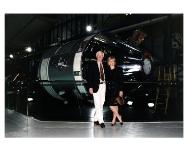 KENNEDY SPACE CENTER, FLA. -- Apollo 9 Lunar Module Pilot Russell L. Schweikart poses in front of an Apollo Command and Service Module in the the new Apollo/Saturn V Center (ASVC) at KSC prior to the gala grand opening ceremony for the facility that was held Jan. 8, 1997. Several Apollo astronauts were invited to participate in the event, which also featured NASA Administrator Dan Goldin and KSC Director Jay Honeycutt. The ASVC also features several other Apollo program spacecraft components, multimedia presentations and a simulated Apollo/Saturn V liftoff. The facility will be a part of the KSC bus tour that embarks from the KSC Visitor Center