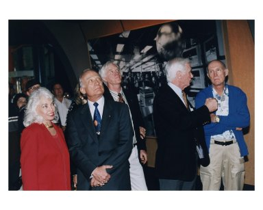 """KENNEDY SPACE CENTER, FLA. -- Some of the former Apollo program astronauts and their family members and friends tour the new Apollo/Saturn V Center (ASVC) at KSC prior to the gala grand opening ceremony for the facility that was held Jan. 8, 1997. The astronauts were invited to participate in the event, which also featured NASA Administrator Dan Goldin and KSC Director Jay Honeycutt. Observing one of the displays inside the ASVC are (from left): Lois Aldrin, wife of Apollo 11 Lunar Module Pilot Edwin E. """"Buzz"""" Aldrin, Jr.; Aldrin; Apollo 9 Lunar Module Pilot Russell L. Schweickart; Apollo 10 Lunar Module Pilot and Apollo 17 Commander Eugene A. Cernan; and Apollo 10 Commander Thomas P. Stafford. The ASVC also features several other Apollo program spacecraft components, multimedia presentations and a simulated Apollo/ Saturn V liftoff. The facility will be a part of the KSC bus tour that embarks from the KSC Visitor Center"""
