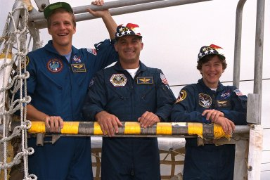 KENNEDY SPACE CENTER, Fla. -- STS-86 Mission Specialists Scott E. Parazynski, at left, David A. Wolf, and Wendy B. Lawrence, at right, participate in emergency egress training at Launch Pad 39A as part of Terminal Countdown Demonstration Test (TCDT) activities. They are the three U.S. astronauts who will serve as mission specialists during the planned 10-day flight to the Russian Space Station Mir. Also serving as mission specialists will be Vladimir Georgievich Titov of the Russian Space Agency and Jean-Loup J.M. Chretien of the French Space Agency, CNES. STS-86 will be the seventh docking of the Space Shuttle with the Mir. During the docking, Wolf will transfer to the orbiting Russian station and become a member of the Mir 24 crew, replacing U.S. astronaut C. Michael Foale, who has been on the Mir since the last docking mission, STS-84, in May. Launch of Mission STS-86 aboard the Space Shuttle Atlantis is targeted for Sept. 25