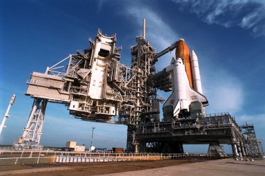 With the Rotating Service Structure rolled back, at left, the Space Shuttle Atlantis undergoes final prelaunch preparations at Launch Pad 39A for the STS-86 mission. One of the final steps will be to load the external tank with approximately 500,000 gallons of liquid hydrogen and liquid oxygen for fueling the orbiter?s three main engines. STS-86 is slated to be the seventh docking of the Space Shuttle with the Russian Space Station Mir. Liftoff is targeted for Sept. 25 at 10:34 p.m. EDT during a preferred launch window which lasts six minutes and 45 seconds. Seven crew members will lift off for the scheduled 10-day flight. One of those crew members, David A. Wolf, will transfer to the Mir for an approximate four-month stay. He will replace U.S. astronaut C. Michael Foale, who will return to Earth with the remainder of the STS86 crew. Foale has been on the Russian space station since mid-May