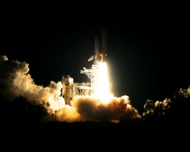 The Space Shuttle Atlantis blazes through the night sky to begin the STS-86 mission, slated to be the seventh of nine planned dockings of the Space Shuttle with the Russian Space Station Mir. Liftoff on Sept. 25 from Launch Pad 39A was at 10:34:19 p.m. EDT, within seconds of the preferred time, during a six-minute, 45-second launch window. The 10-day flight will include the transfer of the sixth U.S. astronaut to live and work aboard the Mir. After the docking, STS-86 Mission Specialist David A. Wolf will become a member of the Mir 24 crew, replacing astronaut C. Michael Foale, who will return to Earth aboard Atlantis with the remainder of the STS-86 crew. Foale has been on the Russian Space Station since mid-May. Wolf is scheduled to remain there about four months. Besides Wolf (embarking to Mir) and Foale (returning), the STS-86 crew includes Commander James D. Wetherbee, Pilot Michael J. Bloomfield, and Mission Specialists Wendy B. Lawrence, Scott E. Parazynski, Vladimir Georgievich Titov of the Russian Space Agency, and Jean-Loup J.M. Chretien of the French Space Agency, CNES. Other primary objectives of the mission are a spacewalk by Parazynski and Titov, and the exchange of about three-and-a-half tons of science/logistical equipment and supplies between Atlantis and the Mir