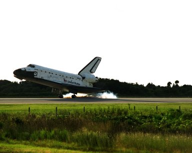KENNEDY SPACE CENTER, Fla. -- The Space Shuttle orbiter Atlantis touches down on Runway 15 of the KSC Shuttle Landing Facility (SLF) to complete the nearly 11-day STS-86 mission. Main gear touchdown was at 5:55:09 p.m. EDT on Oct. 6, 1997. The unofficial mission-elapsed time at main gear touchdown was 10 days, 19 hours, 20 minutes and 50 seconds. The first two landing opportunities on Sunday were waved off because of weather concerns. The 87th Space Shuttle mission was the 40th landing of the Shuttle at KSC. On Sunday evening, the Space Shuttle program reached a milestone: The total flight time of the Shuttle passed the two-year mark. STS-86 was the seventh of nine planned dockings of the Space Shuttle with the Russian Space Station Mir. STS-86 Mission Specialist David A. Wolf replaced NASA astronaut and Mir 24 crew member C. Michael Foale, who has been on the Mir since mid-May. Foale returned to Earth on Atlantis with the remainder of the STS-86 crew. The other crew members are Commander James D. Wetherbee, Pilot Michael J. Bloomfield, and Mission Specialists Wendy B. Lawrence, Scott E. Parazynski, Vladimir Georgievich Titov of the Russian Space Agency, and Jean-Loup J.M. Chretien of the French Space Agency, CNES. Wolf is scheduled to remain on the Mir until the STS-89 Shuttle mission in January. Besides the docking and crew exchange, STS-86 included the transfer of more than three-and-ahalf tons of science/logistical equipment and supplies between the two orbiting spacecraft. Parazynski and Titov also conducted a spacewalk while Atlantis and the Mir were docked