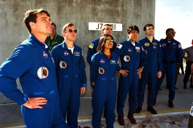 The crew of the STS-87 mission, scheduled for launch Nov. 19 aboard the Space Shuttle Columbia from Pad 39B at Kennedy Space Center (KSC), participates in the Terminal Countdown Demonstration Test (TCDT) at KSC. Getting a look at the Space Shuttle Columbia are, from left, Commander Kevin Kregel; Pilot Steven Lindsey; Mission Specialist Kalpana Chawla, Ph.D.; Payload Specialist Leonid Kadenyuk of the National Space Agency of Ukraine (NSAU); Mission Specialist Takao Doi, Ph.D., of the National Space Development Agency of Japan; Kadenyuk?s back-up, Yaroslav Pustovyi, Ph.D., also of NSAU; and Mission Specialist Winston Scott. The TCDT is held at KSC prior to each Space Shuttle flight providing the crew of each mission opportunities to participate in simulated countdown activities. The TCDT ends with a mock launch countdown culminating in a simulated main engine cut-off. The crew also spends time undergoing emergency egress training exercises at the pad and has an opportunity to view and inspect the payloads in the orbiter's payload bay