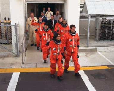 The crew of Mission STS-87 depart from the Operations and Checkout Building en route to Launch Pad 39B, where the Space Shuttle Columbia awaits liftoff on the fourth flight of the United States Microgravity Payload and the Spartan-201 deployable satellite. Leading the way are, from left to right, front to back: Mission Specialist Kalpana Chawla, Ph.D.; Commander Kevin Kregel; Mission Specialist Takao Doi, Ph.D., of the National Space Development Agency of Japan; Mission Specialist Winston Scott; Payload Specialist Leonid Kadenyuk of the National Space Agency of Ukraine; and Pilot Steven Lindsey. The Space Shuttle Columbia and its crew of six members are scheduled to lift off during a two-and-a-half hour launch window, which opens at 2:46 p.m