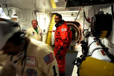 STS-87 Mission Specialist Winston Scott is assisted with his ascent and re-entry flight suit in the white room at Launch Pad 39B by Danny Wyatt, NASA quality assurance specialist. STS-87 is the fourth flight of the United States Microgravity Payload and Spartan-201. Scott is scheduled to perform an extravehicular activity spacewalk with Mission Specialist Takao Doi, Ph.D., of the National Space Development Agency of Japan, during STS-87. Scott also performed a spacewalk on the STS-72 mission