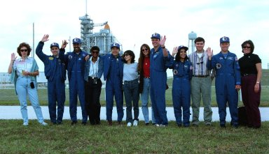 The crew of STS-87 pose with their spouses in front of Kennedy Space Center?s Launch Pad 39B during final prelaunch activities leading up to the scheduled Nov. 19 liftoff. From left to right are: Vera Kadenyuk, wife of Payload Specialist Leonid Kadenyuk of the National Space Agency of Ukraine who is next to Vera; Mission Specialist Winston Scott and his wife, Marilyn; Mission Specialist Takao Doi, Ph.D., of the National Space Development Agency of Japan, and his wife, Hitomi; Jeannie Kregel, who is married to Commander Kevin Kregel standing next to her; Mission Specialist Kalpana Chawla, Ph.D., and her husband, Jean-Pierre Harrison; and Pilot Steven Lindsey and his wife Diane. STS-87 will be the fourth flight of the United States Microgravity Payload and the Spartan-201 deployable satellite